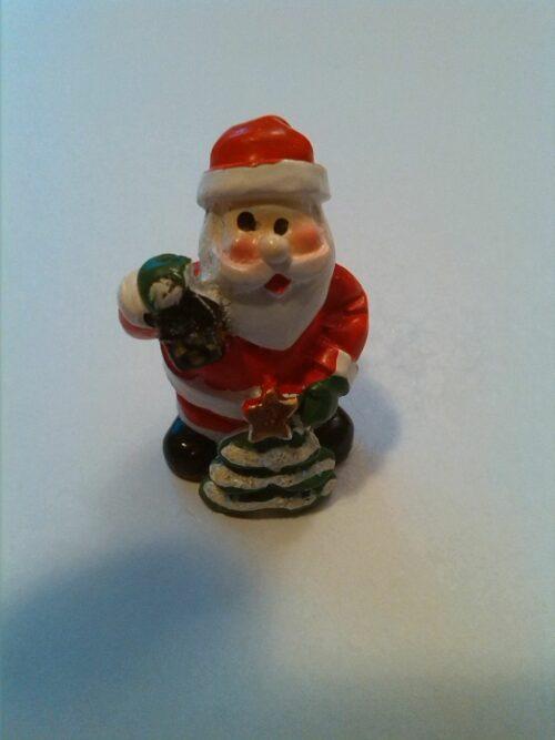Glücksbringer Weihnachtsmann mit Laterne und Weihnachtsbaum mit Stern