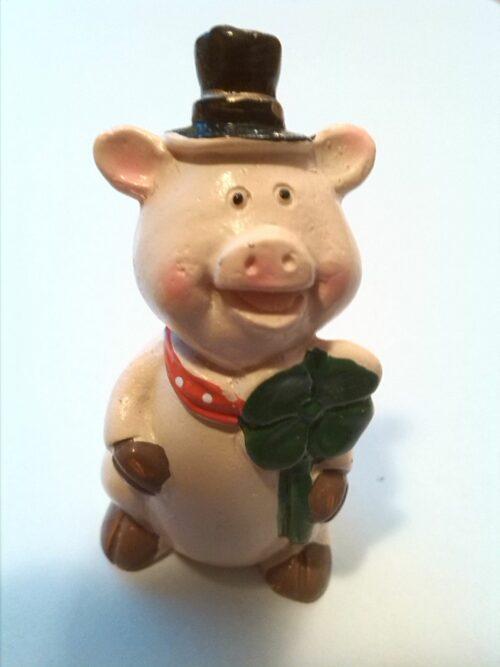 Glücksbringer Schwein mit vierblättrigem Kleeblatt und Zylinder